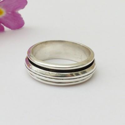 Bague argent avec un anneau mobile au milieu