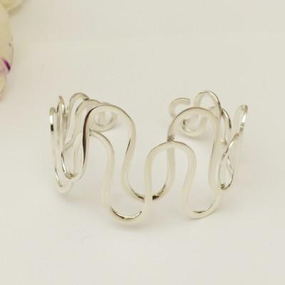 Bracelet en argent deux tiges en vagues croisées