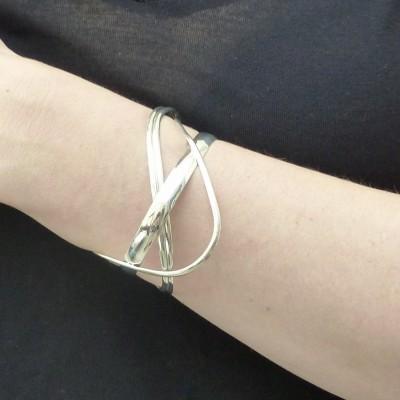Bracelet en argent quatre tiges croisées